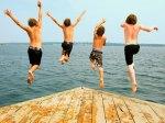 4 boys jumping off dock