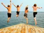 4 boys jumping off dock